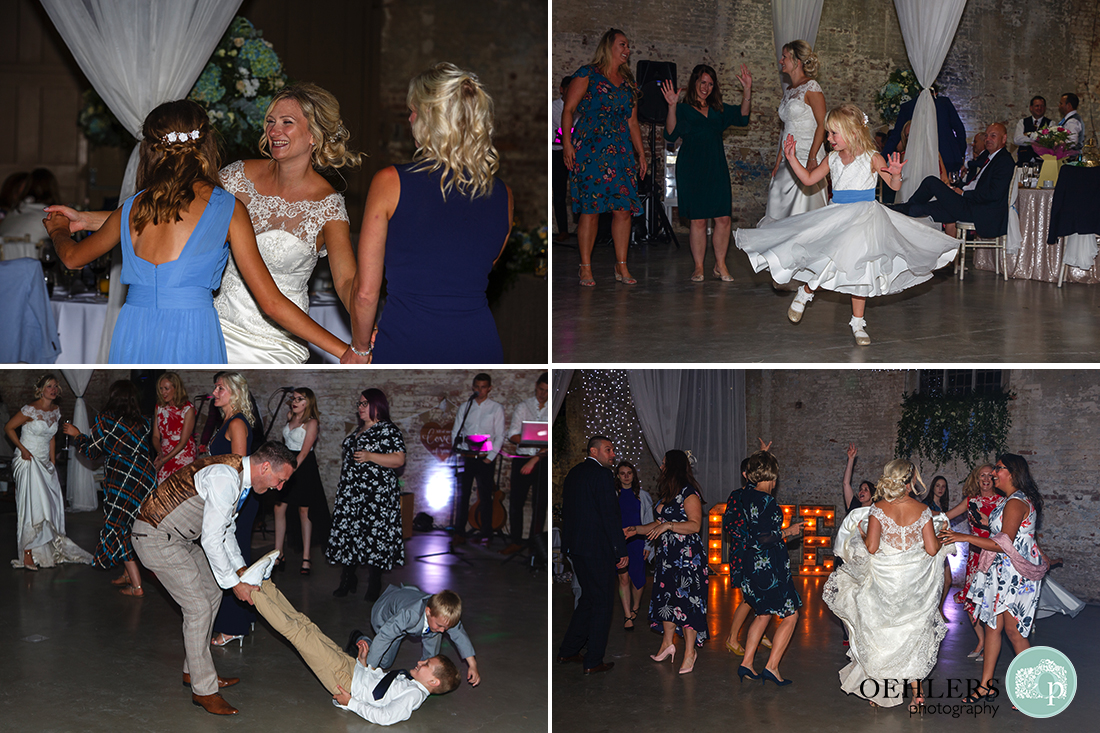 guests and bride on the dance floor showing off their moves