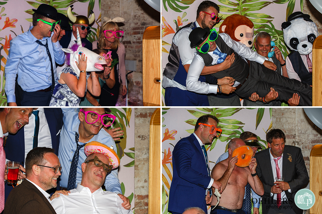 drunk guests using props in a Photo Booth