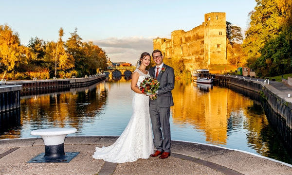 couple posing in front of Newark Castle