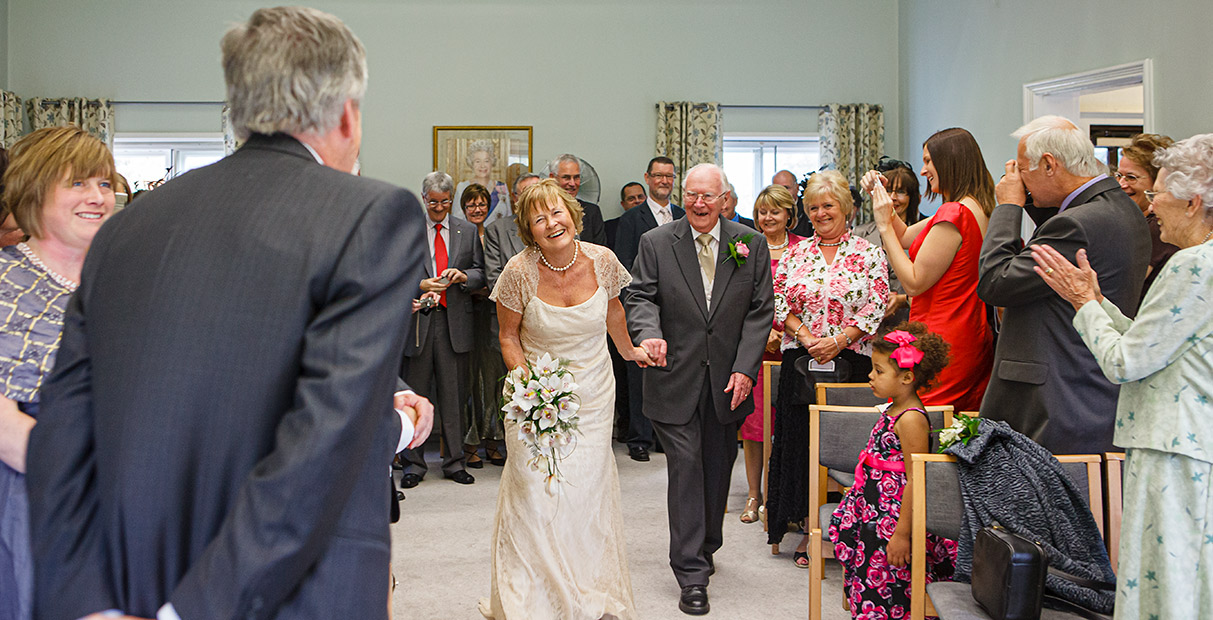 Nottingham Wedding Photographers-Bride so happy to see her groom as she walks down the aisle