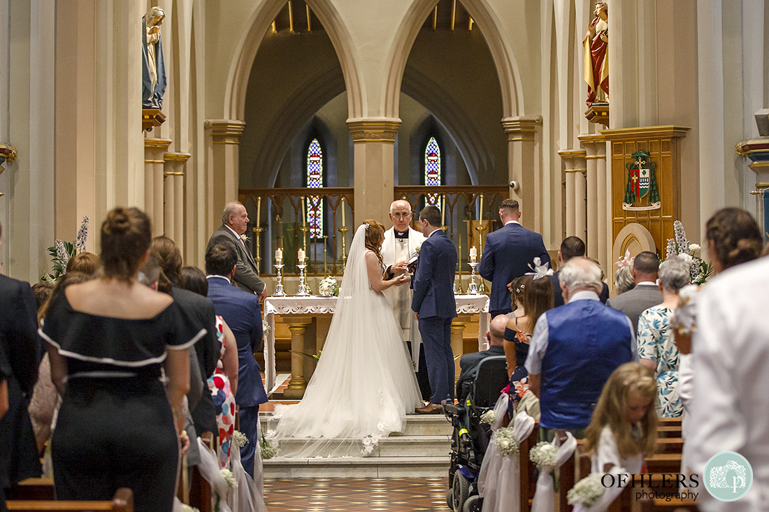 Bride and Groom saying their vows in St Barnabas Cathedral, Nottingham.