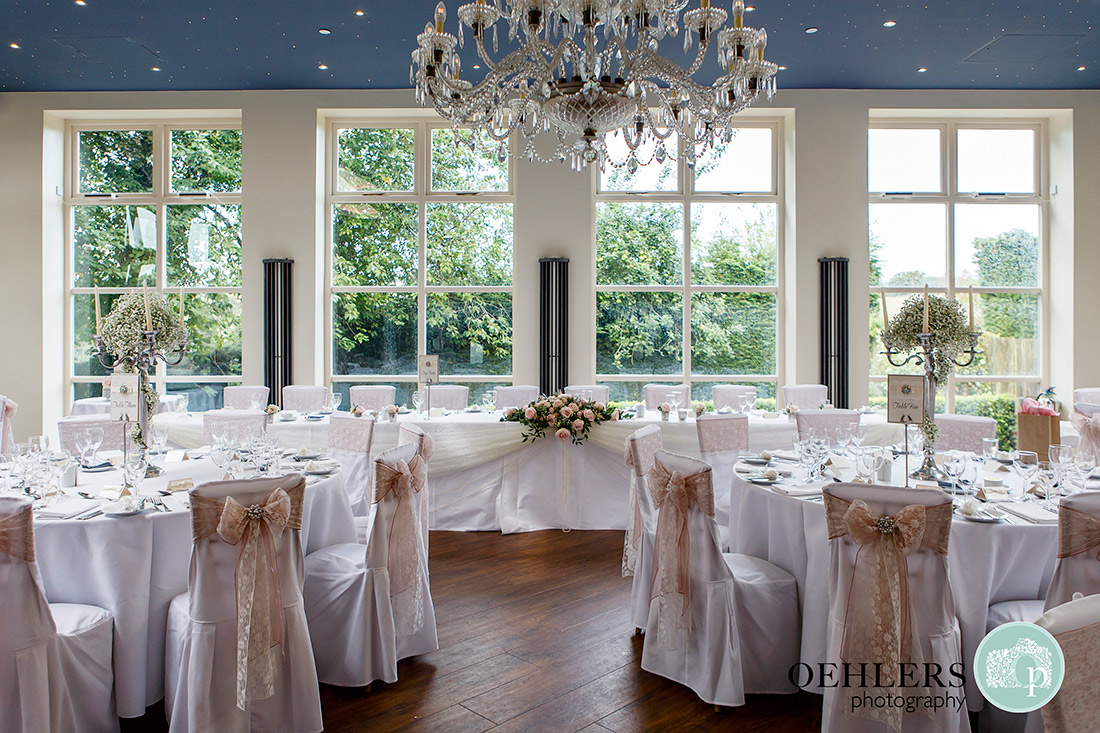 Dressed up wedding breakfast room in the Orangery of Shottle Hall.