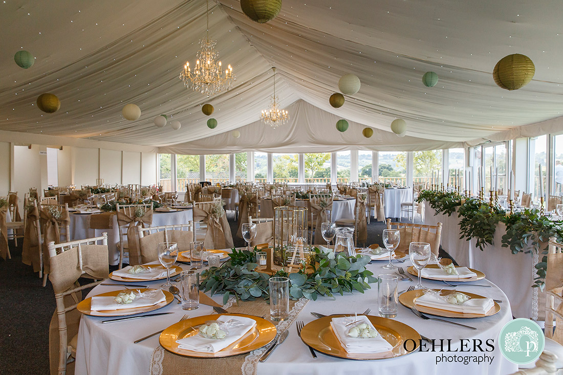 Beautiful gold and munty decorations in the marquee.