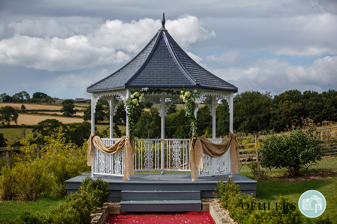 Shottle Hall's gazebo decked with hessian and flowers.