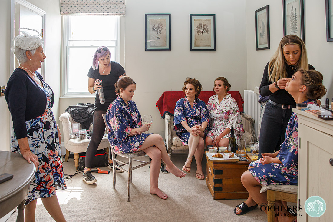 Kedleston Country House Photographers - Bridal party and aunt relaxing.