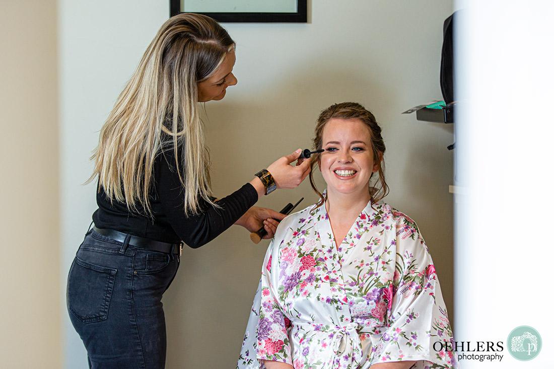 Bride having make-up done.