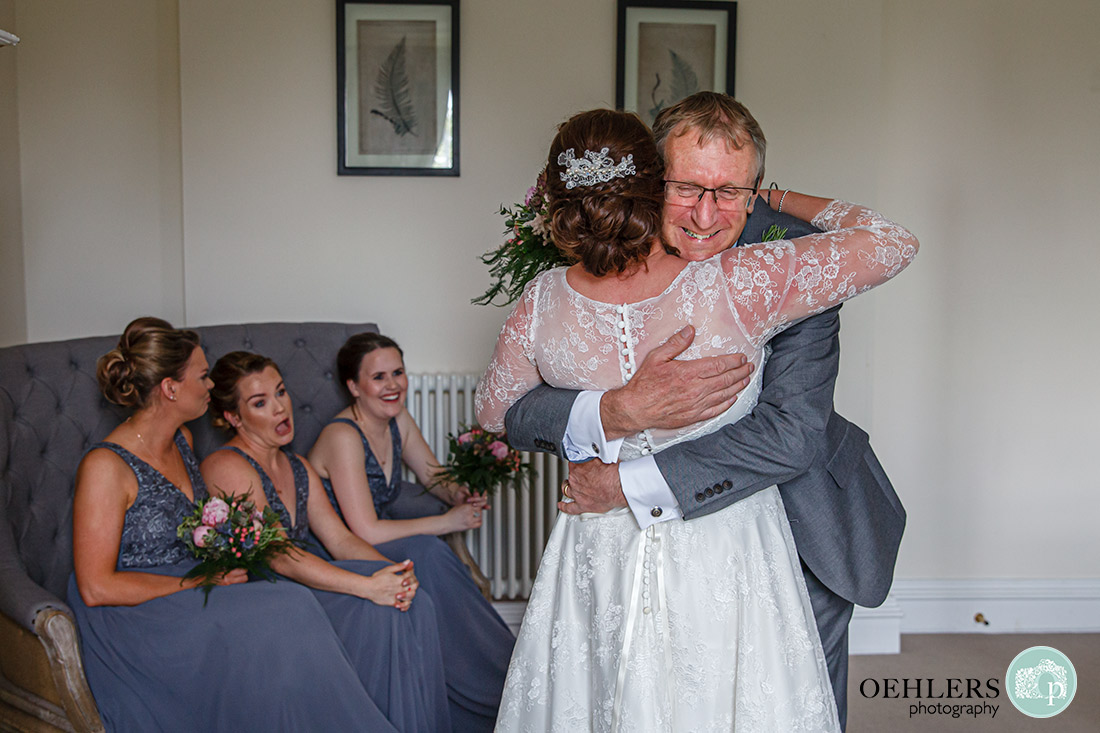 A ginormous hug given by brides good friend.