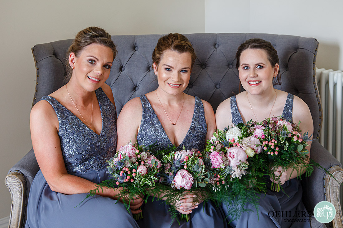 Posed photo of bridesmaids on the sofa in the bridal suite.
