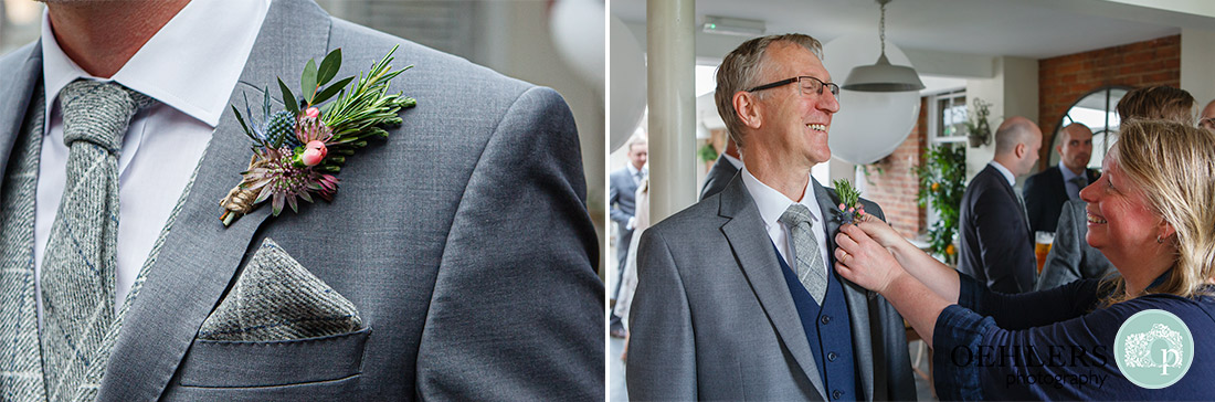 Buttonholes being put onto the groomsmen.