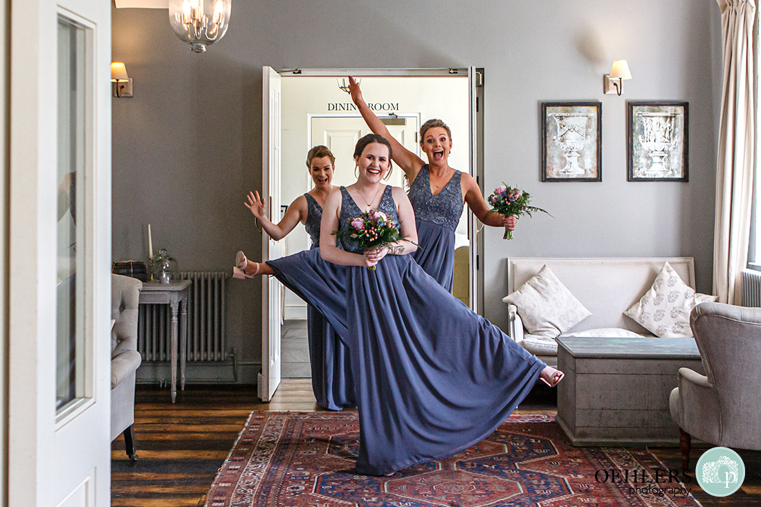 Kedleston Country House Photographers - bridesmaids having fun before entering the wedding ceremony room.