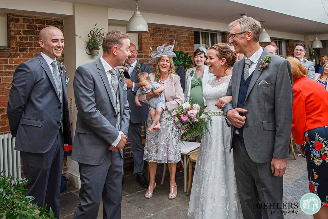 Kedleston Country House Photographers - an amazed look on the groom's face as he looks at his bride.