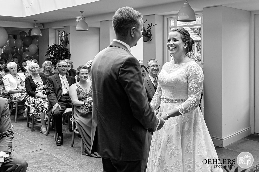 Kedleston Country House Photographers - couple looking at each other at the ceremony table.