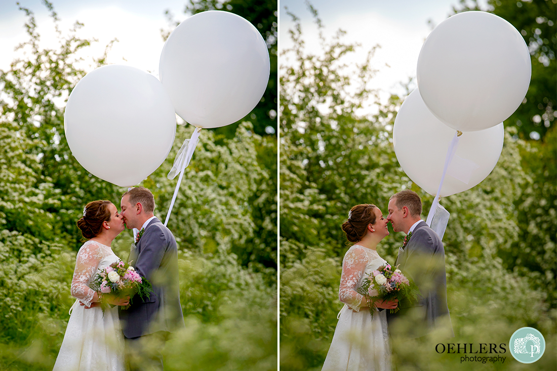 Kedleston Country House Photographers - a romantic kiss with balloons.