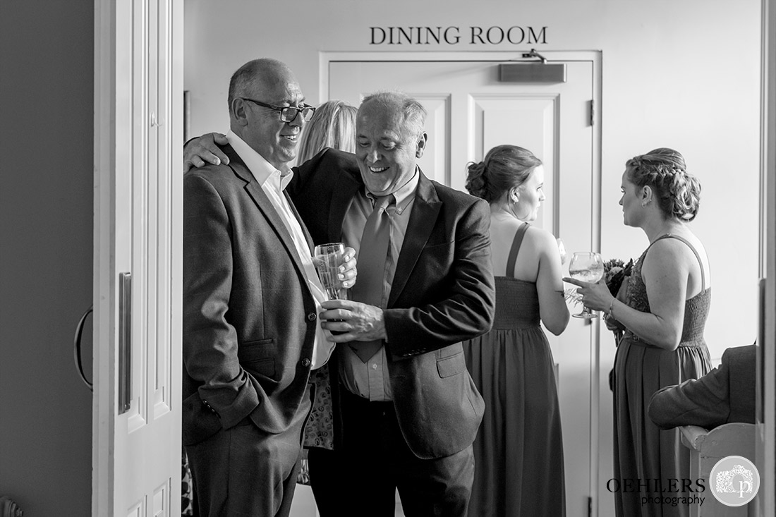 Kedleston Country House Photographers - inside shot of guests enjoying each others company.