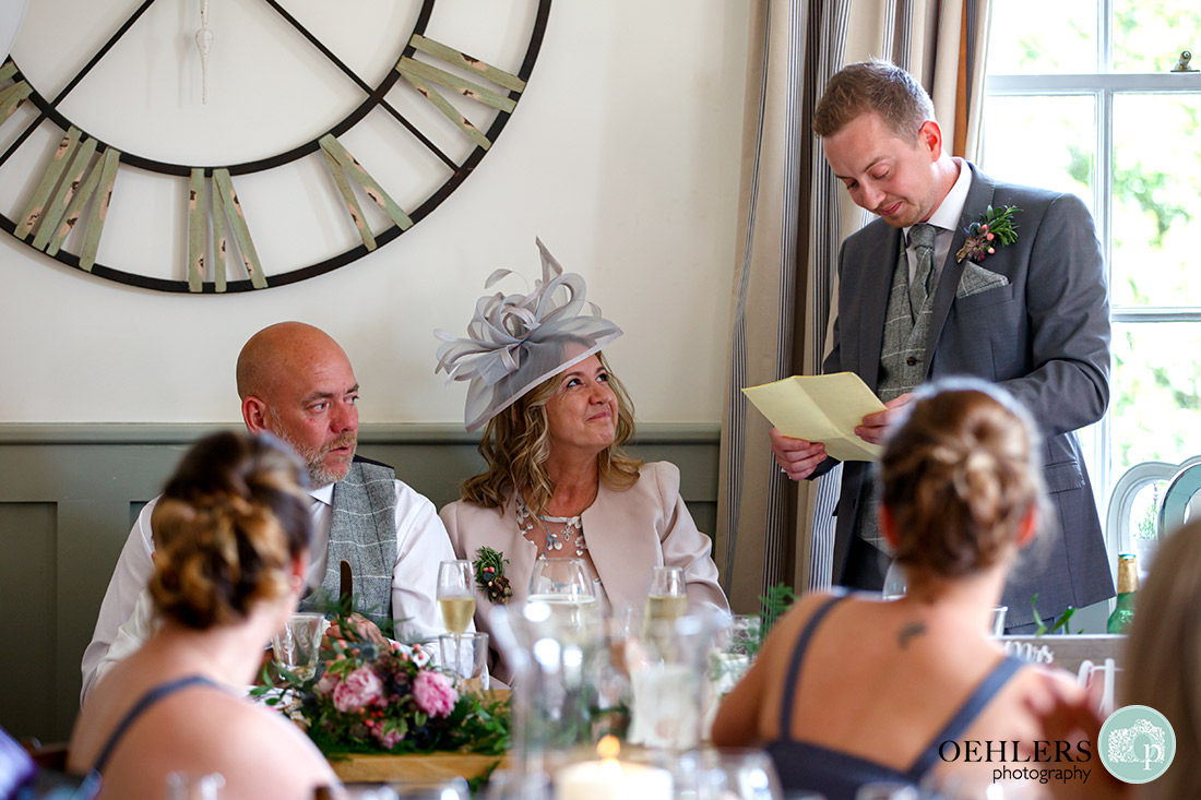 Kedleston Country House Photographers - Groom talking about his parents during the speeches.