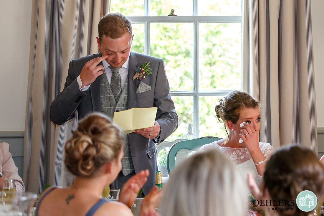 Kedleston Country House Photographers - teary bride and groom during the speeches.