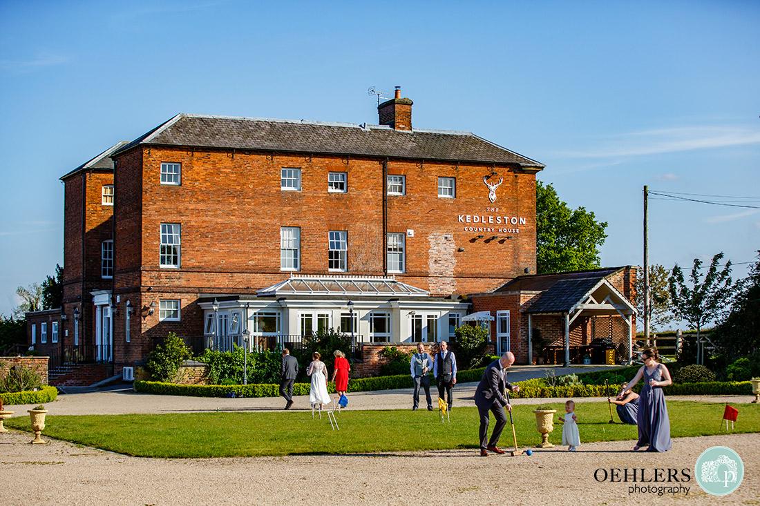 Kedleston Country House Photographers - outside in the grounds of Kedleston Country House playing croquet.