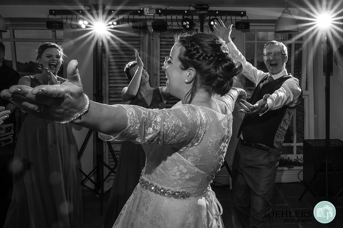 Bride having a dance with friends.