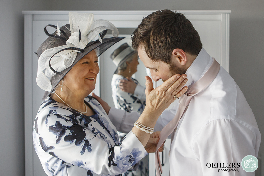 A lovely moment between the groom and his mother.