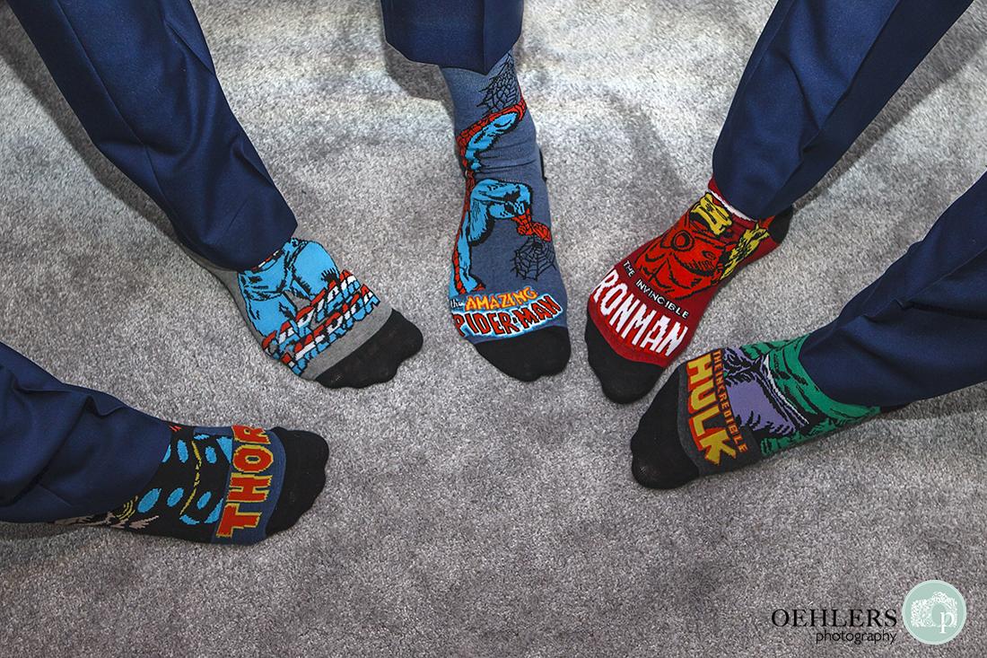 Superhero socks displayed by the groomsmen.