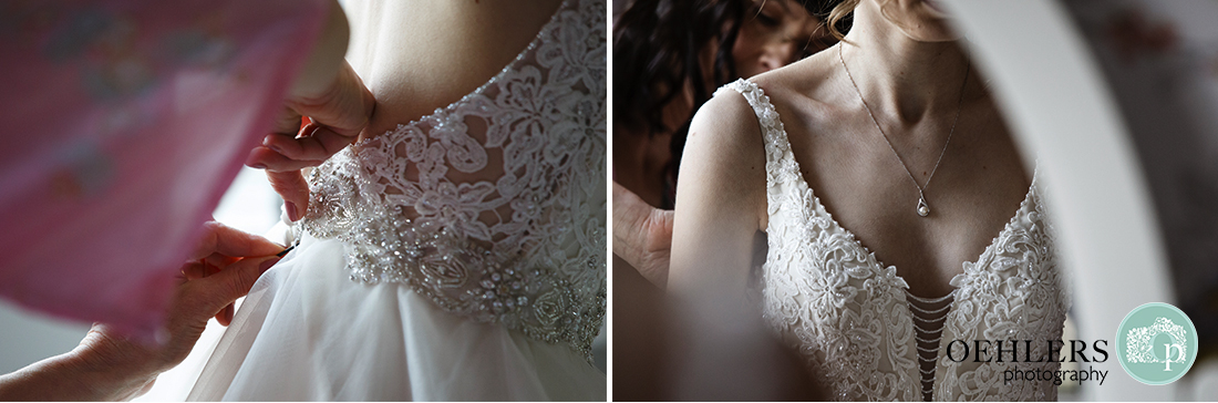 Close up of brides dress being done up and another of her necklace round her neck.