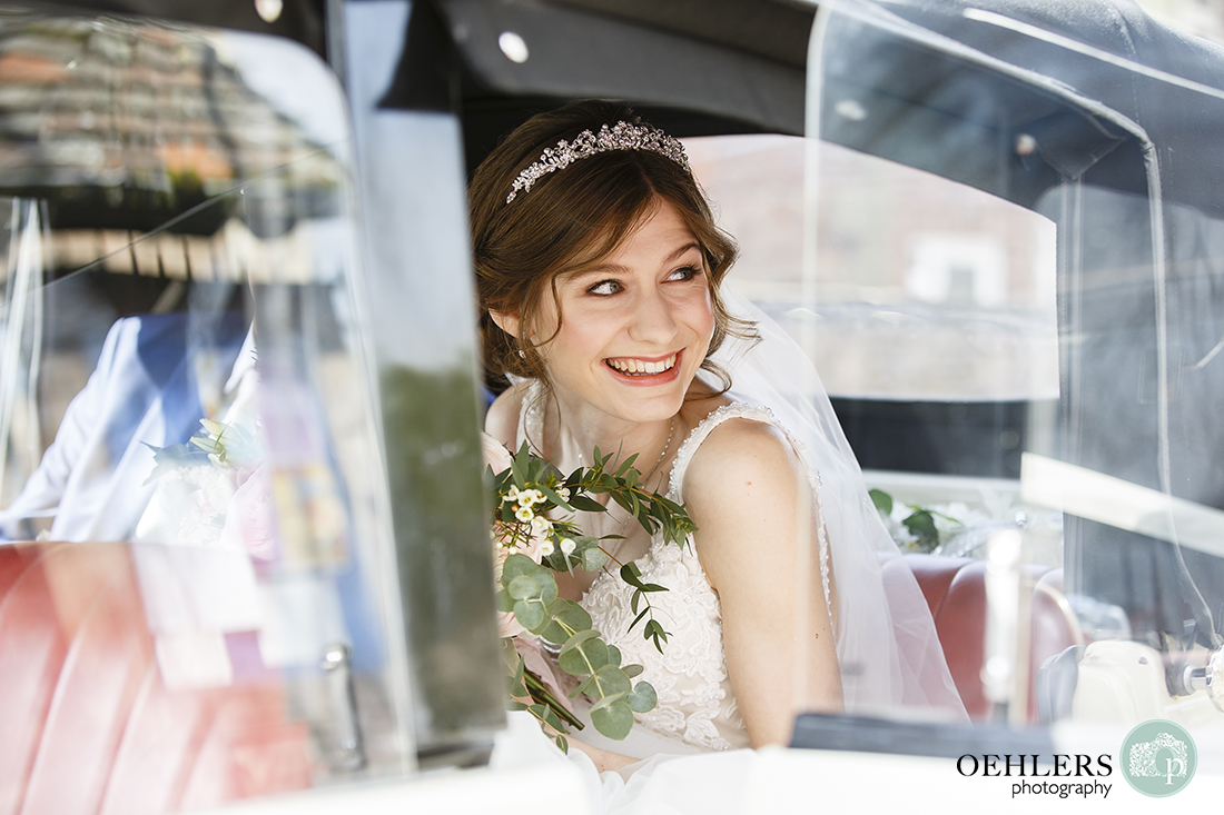 Bride looking out of her wedding car as she arrives at the church.