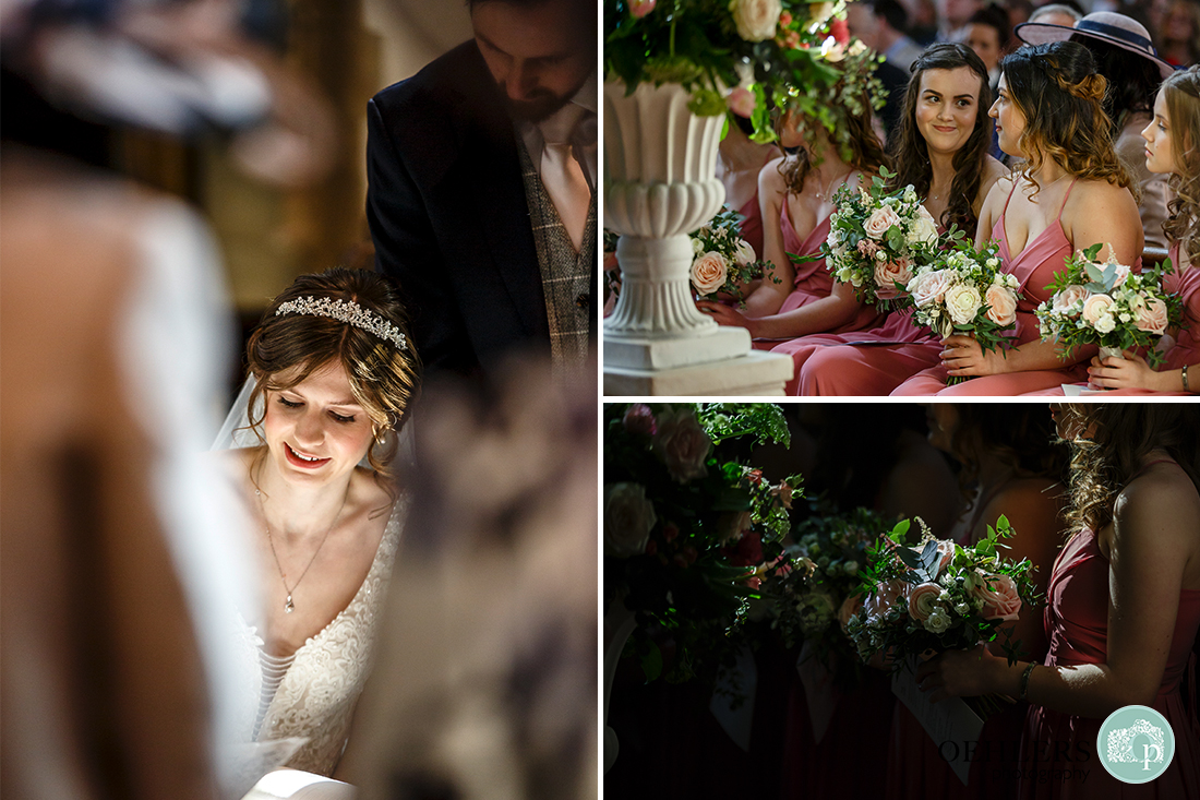 Groom stands over the bride whilst she signs the register. The bridesmaids holding their bouquets in the congregation.
