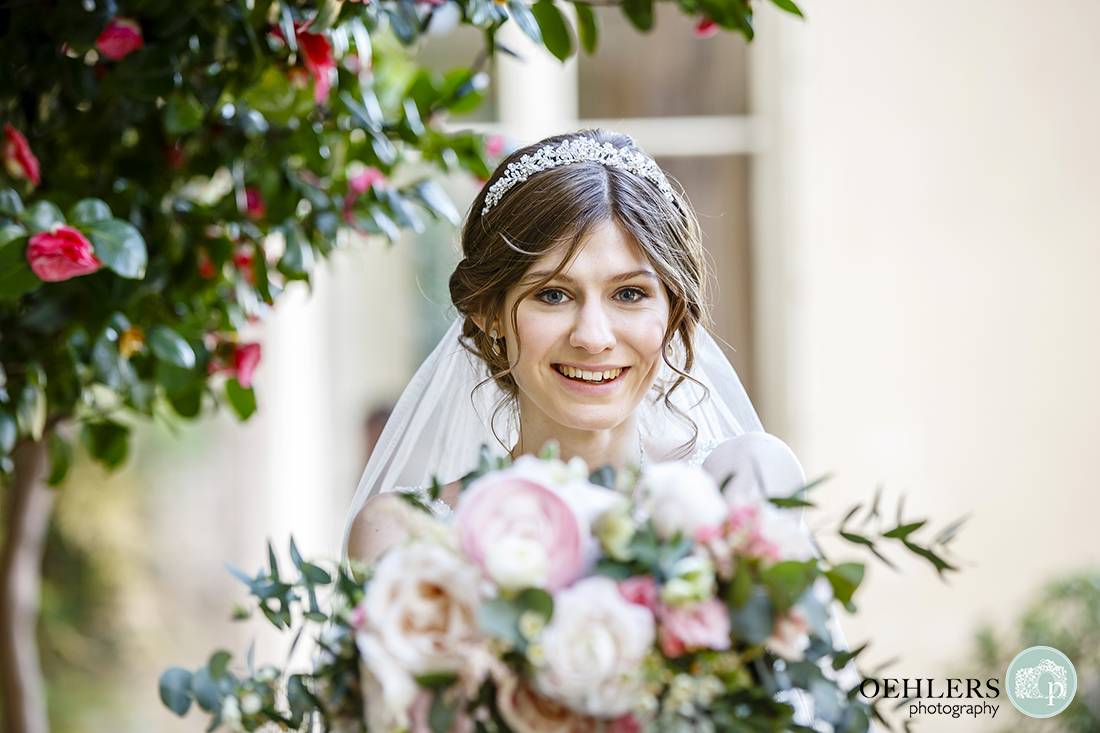 A portrait of the bride in the conservatory.