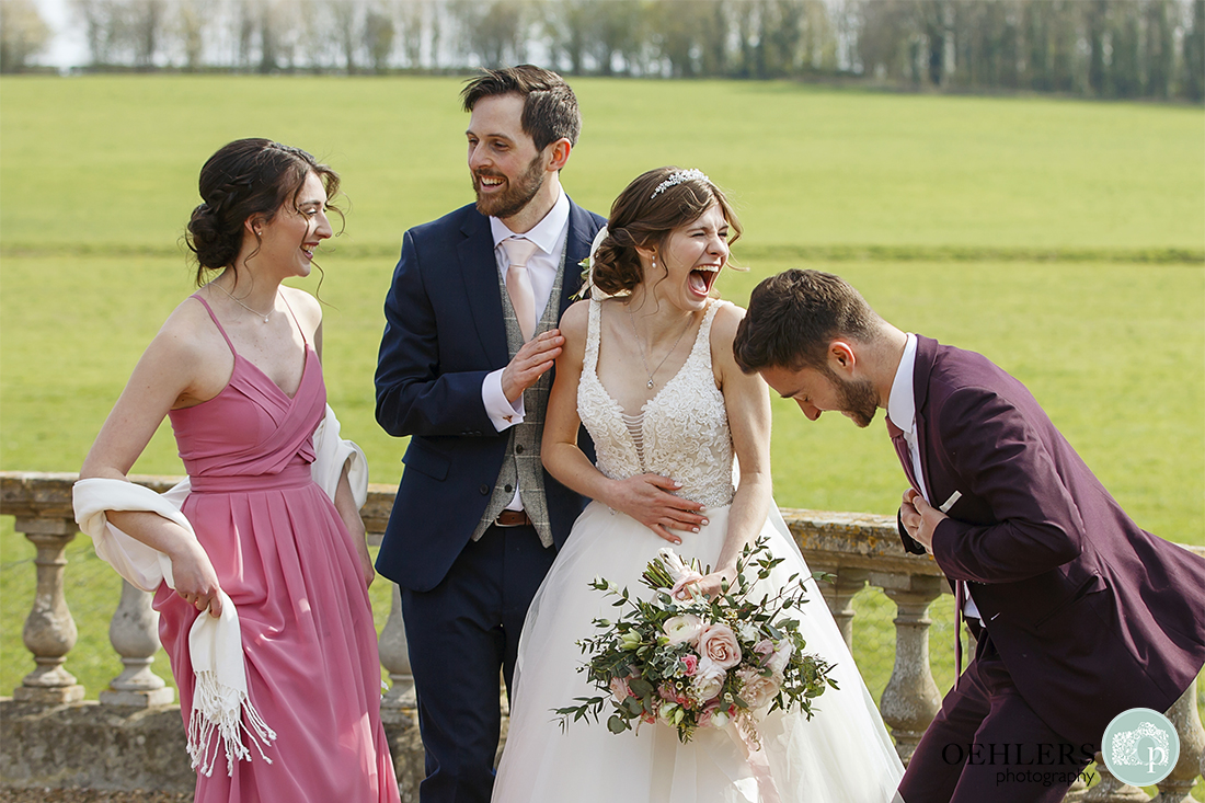 Bride and Groom having a laugh with their friends.