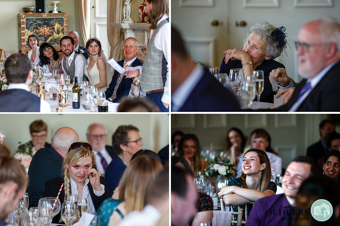 Images of the guests responding to the bestman's speech in the wedding breakfast room at Prestwold Hall.