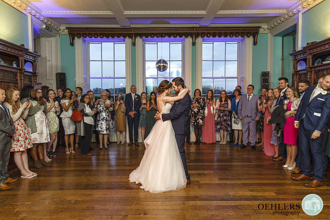 A romantic first dance in the library of Prestwold Hall whilst everyone is watching.