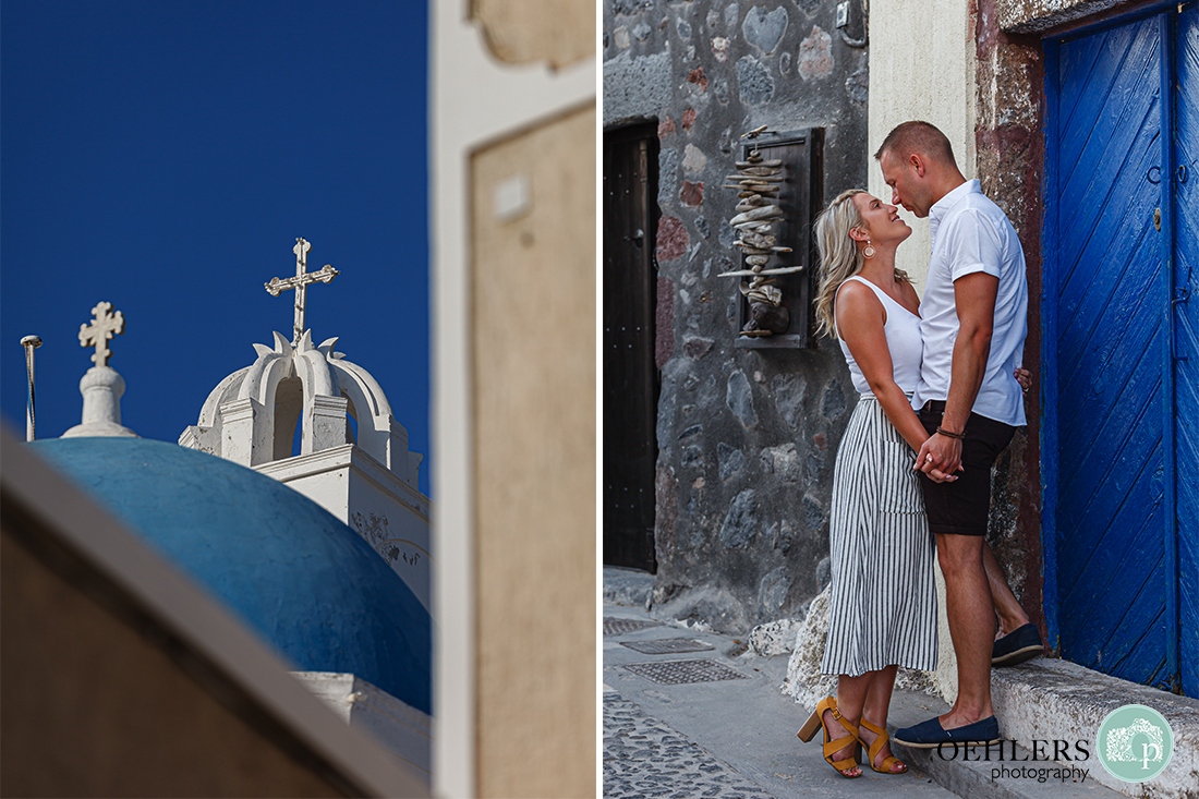 Santorini Wedding Photographers - Blue domes of Santorini and couple looking lovingly at each other.