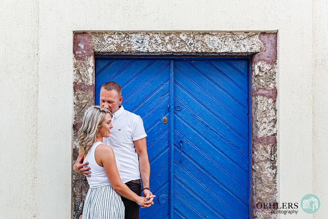 Couple in front of a Blue Door.