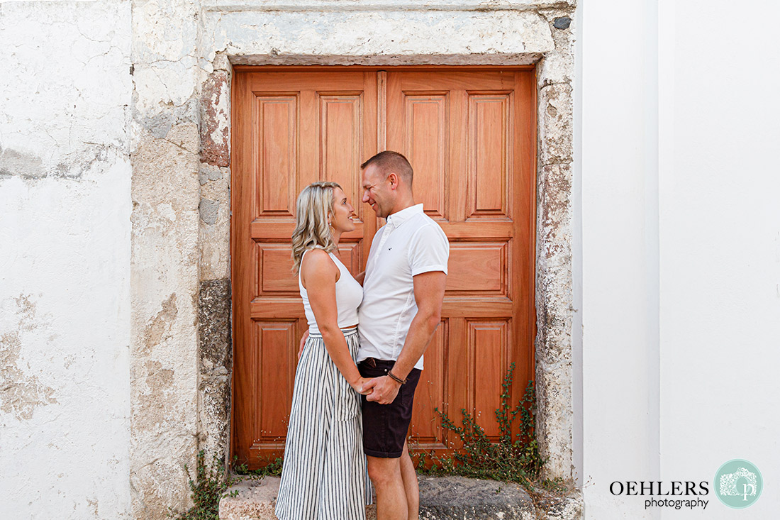 Couple in front of a wooden door.