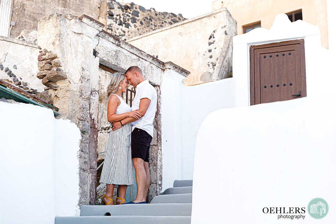 Santorini Wedding Photographers - romantic setting with bride and groom.