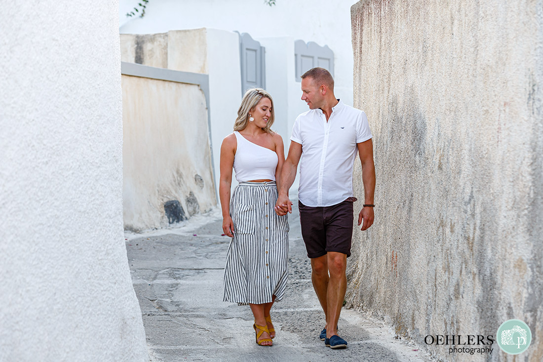 Santorini Wedding Photographers - walking hand in hand through the narrow streets.
