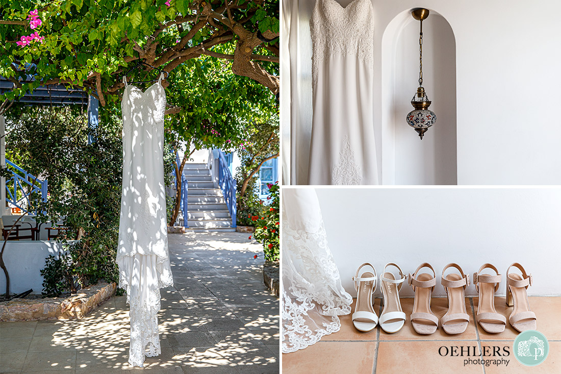 Destination Wedding Photographers - dress hanging from a bougainvillea tree as well as shoes of bridesmaids and bride on the floor.