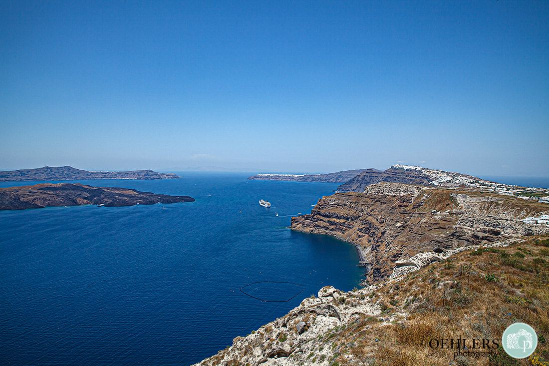 The spectacular view over Santorini's caldera to the blue Aegean Sea.