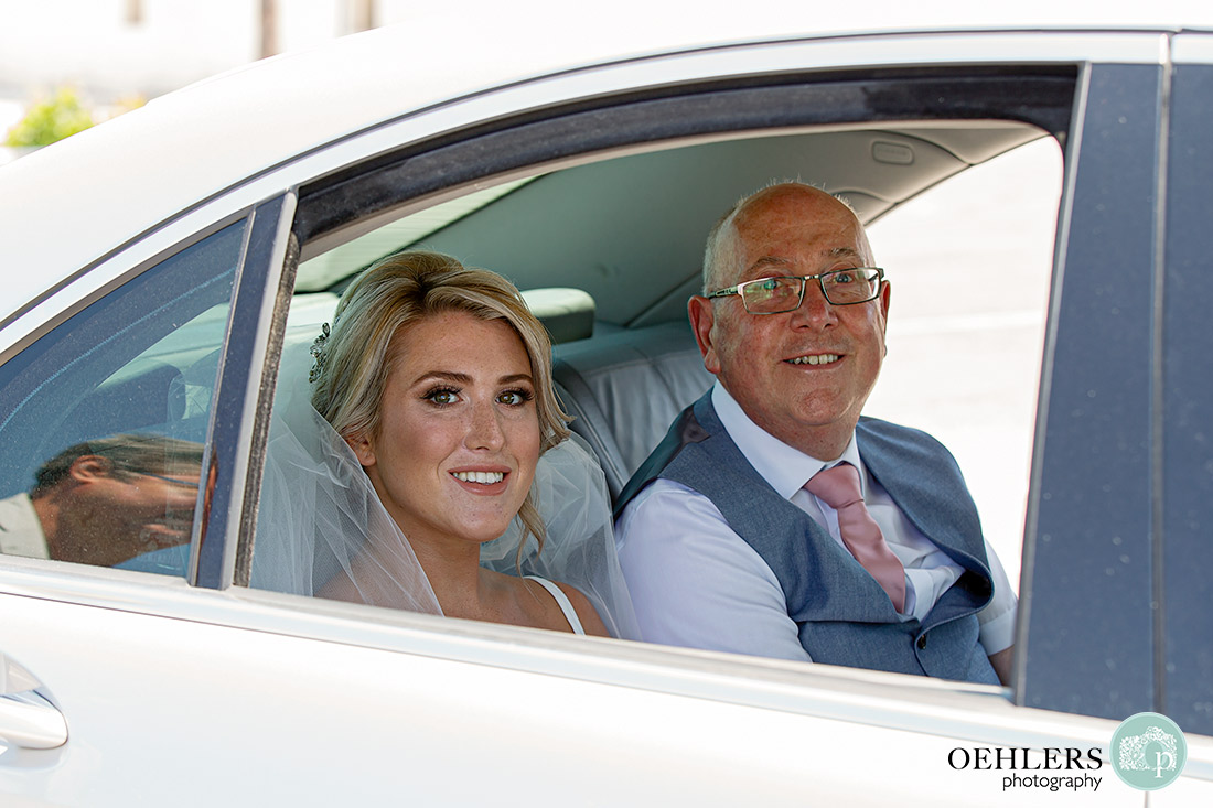 Santos Winery Weddings - bride with her dad in the car arriving.