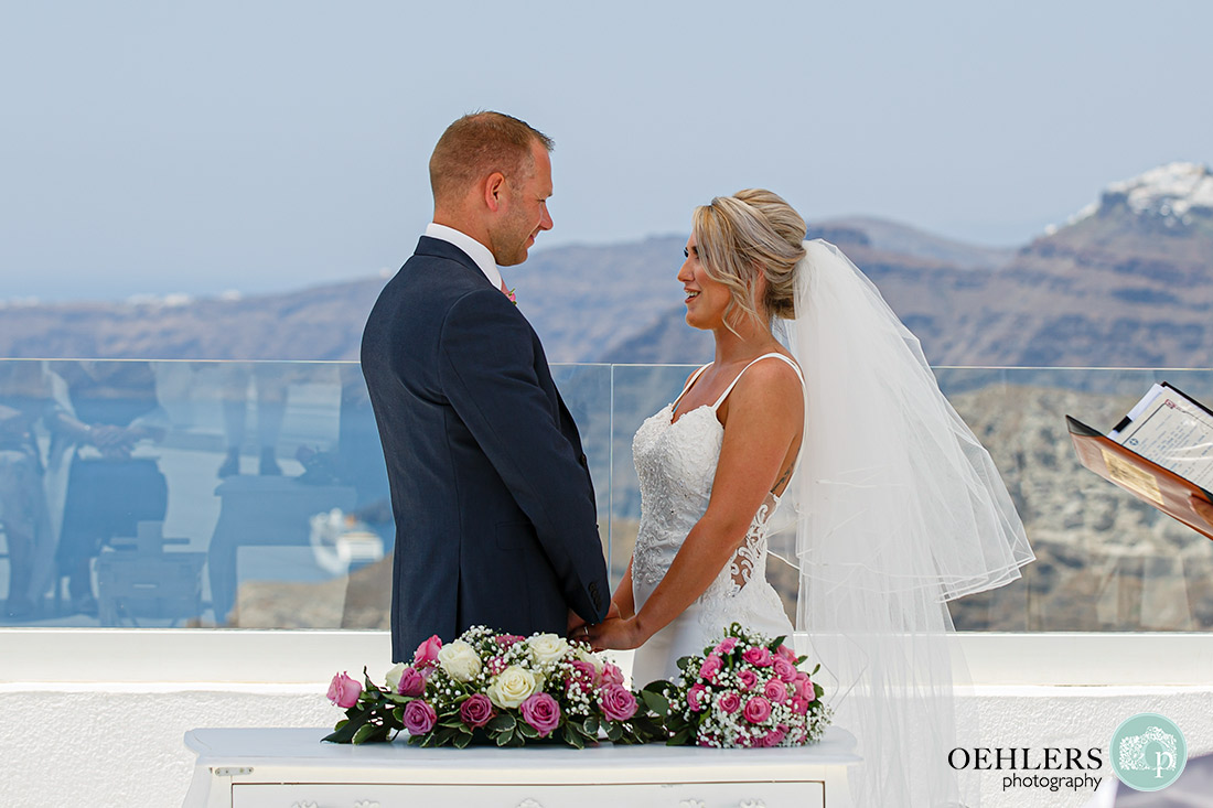Santorini Destination Wedding Photographers - bride and groom saying their vows.