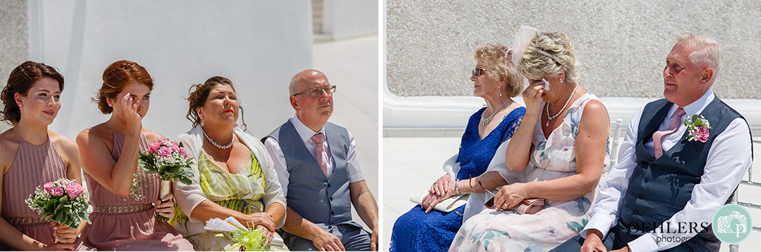 Santorini Destination Wedding Photographers - emotional tears amongst the guests.
