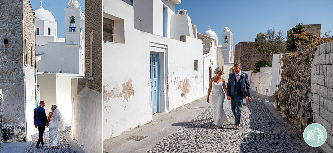 Destination Wedding Photographers - Santorini - walking on the cobbled streets in Santorini.