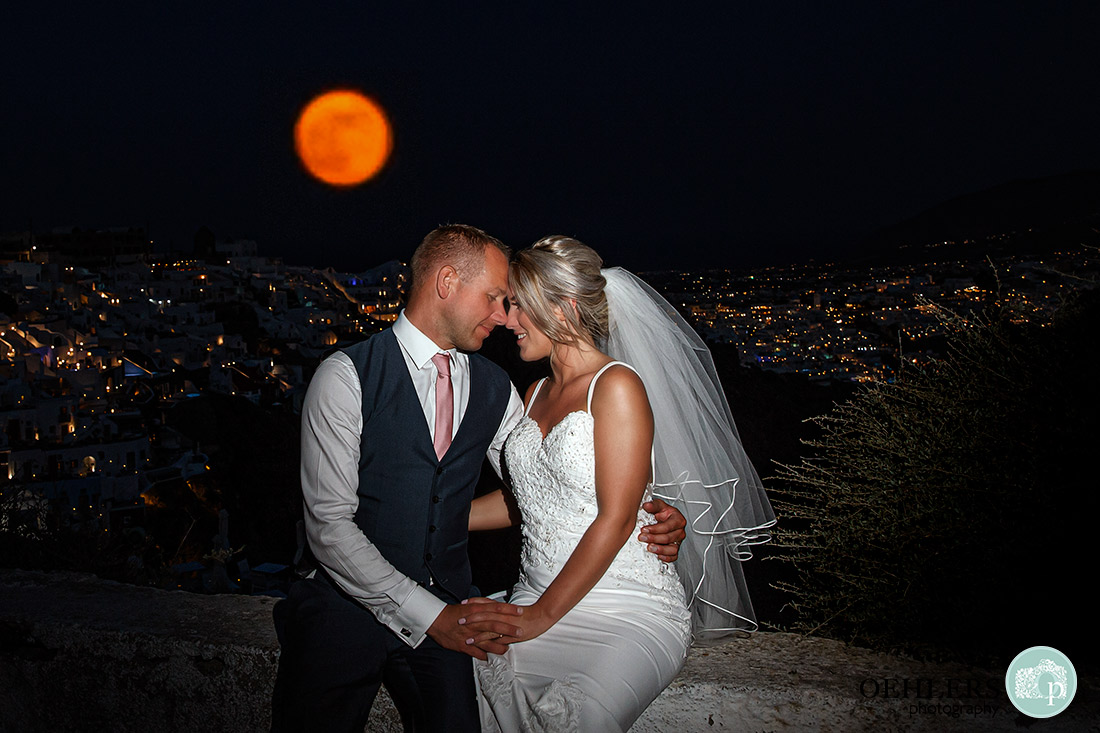 Destination Wedding Photographers - Santorini - An amazing shot of the full moon and santorini town in the background.