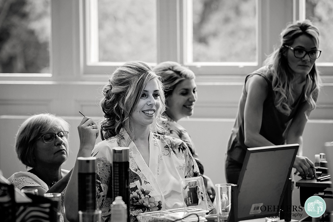 Nottingham wedding photographer - Black and White photo of the bride having jewels put into her hair.