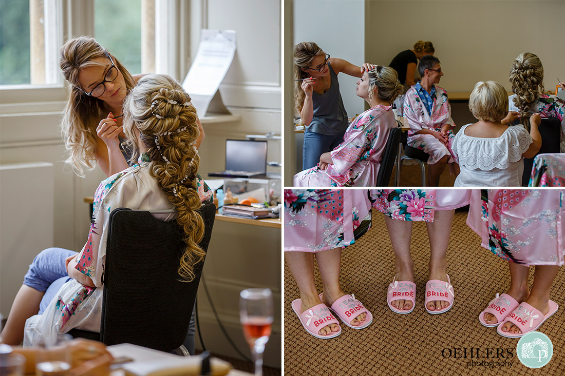 Stoke Rochford Wedding Photographer-Bride and bridal party having their make up done and slippers with Bride embroidered onto their front.