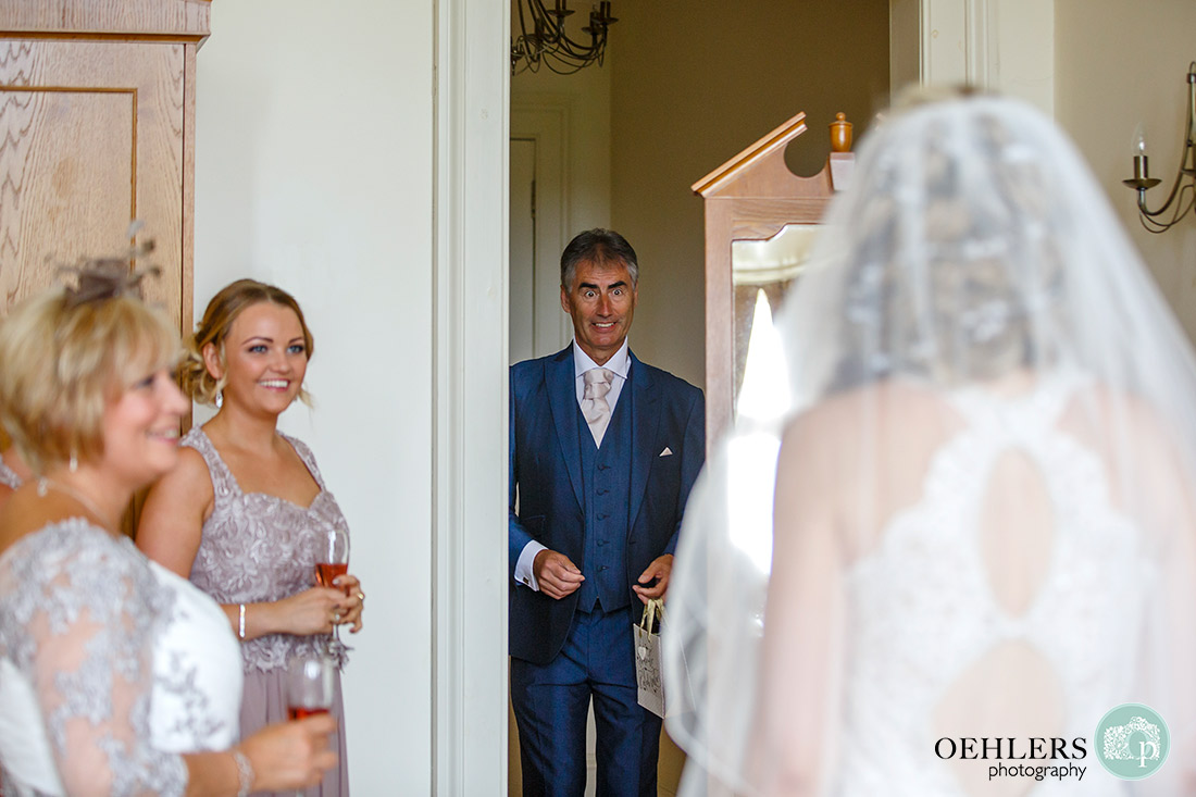 Stoke Rochford Wedding Photographer-Dad enters the bridal suite to see his daughter for the first time in her wedding dress.