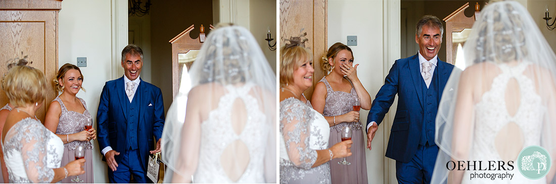 Stoke Rochford Wedding Photographer-Photographs of the happy dad looking at the bride with a bridesmaid in the background in tears.