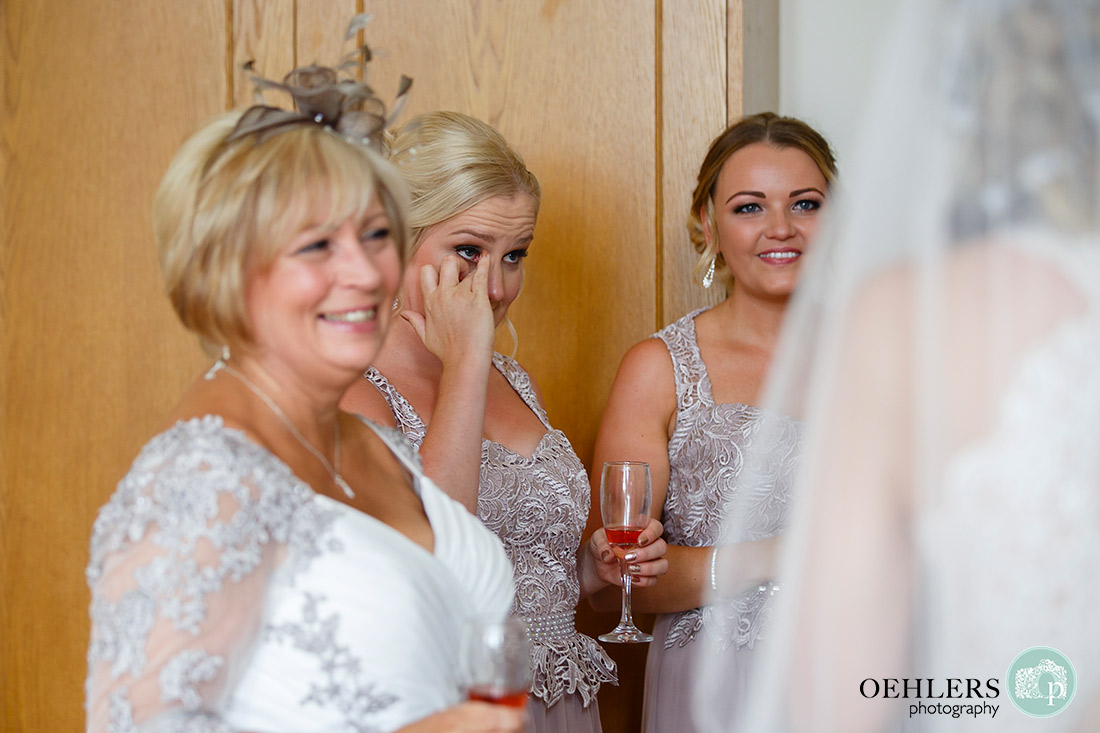 Stoke Rochford Photographer-Close up of one bridesmaid crying and the other smiling.