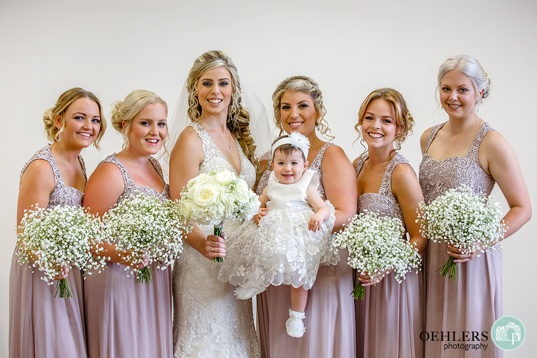 Stoke Rochford Wedding Photographer-Happy Bridal Party looking at the camera.