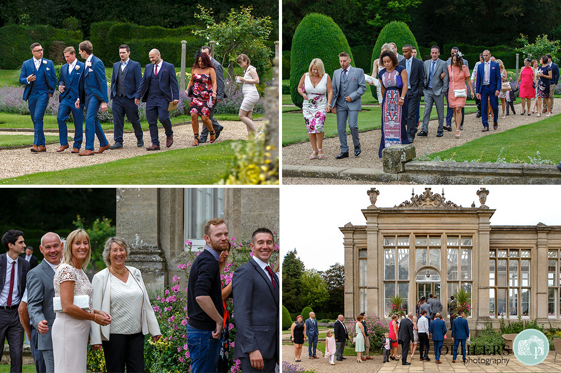 Stoke Rochford Wedding Photographer-Guests walking around the outside of the Orangery to enter the ceremony room.